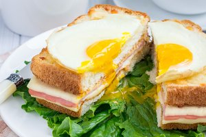 French toasted sandwich Croque madame, cut, closeup