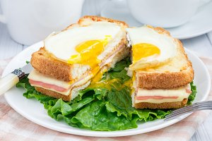 French toasted sandwich Croque madame, cut