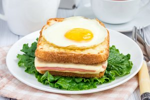 French toasted sandwich Croque madame with ham and cheese