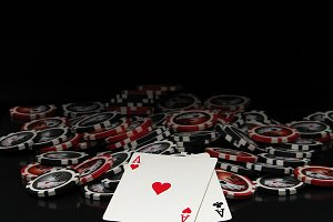 Black and red poker chips and cards