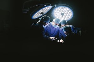 Group of surgeons at work
