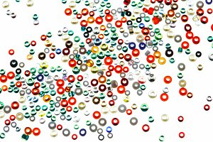 Colorful glass beads isolated on white background.