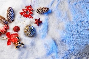 Christmas decorations in snow with blue backlight.