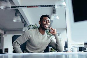 Male executive making phone call