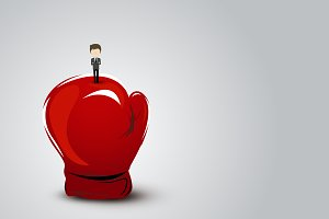 Businessman standing on boxing glove