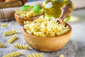 Helix- or corkscrew-shaped pasta. Rotini macaroni. Related to fusilli, but has a tighter helix, i.e. with a smaller pitch