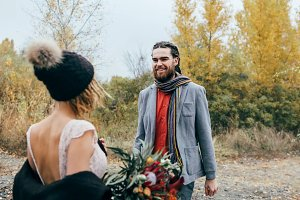 First meeting of bride and groom. The groom goes to the bride. Autumn wedding ceremony outdoors. Artwork