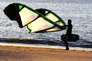 backlight kitesurfer on the beach