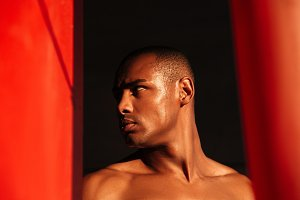 Close up portrait of a young half naked african sportsman