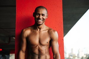 Portrait of an attractive smiling half naked african sportsman