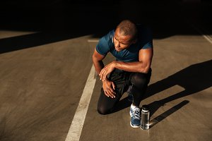 Portrait of a fit african sportsman with water bottle
