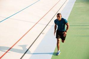 Full length portrait of a muscular sportsman running
