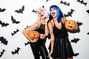 Emotional young women in halloween costumes