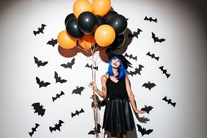 Emotional young woman in witch halloween costume