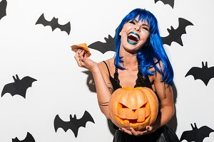 Gorgeous young woman in witch halloween costume
