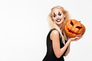 Portrait of a smiling blonde woman in halloween make up