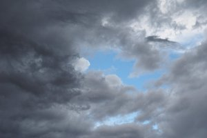 dark blue sky with clouds background