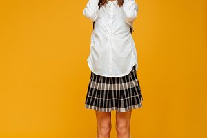 Full length portrait of a cheerful schoolgirl