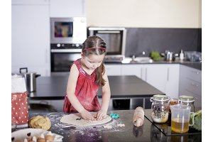 little cute girl is learning how to make cake, in kitchen, Family concept