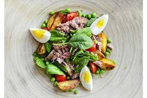 Tuna salad with lettuce, eggs and tomatoes.