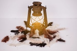 Lighted Lantern and feathers