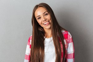 Portrait of a beautiful smiling woman in plaid shirt