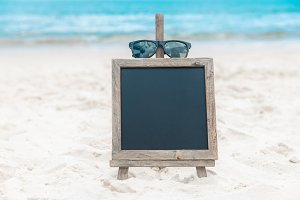 Chalk board on a beach