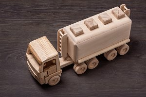 Wooden toy car gas carrier.