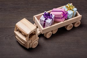 Toy wooden truck with gift boxes.