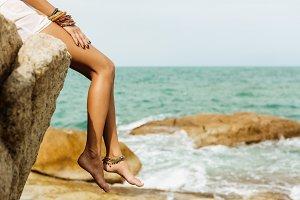 Beautiful woman at stone beach.