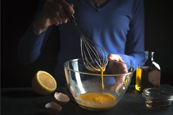 Beat yolks in a glass bowl with whi…