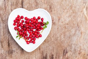 Cranberries in heart shape plate