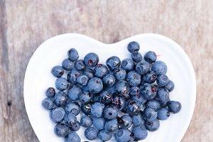 Blueberries in heart shape plate
