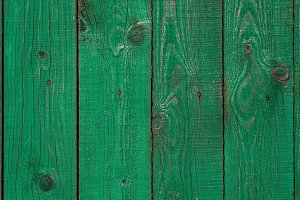 Dark lime vintage wooden boards. Backgrounds and textures fence painted. Front view. Attract a beautiful vintage background.