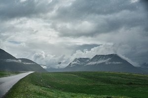 A mountain road to the town of Isafjordur and a view of the fjord