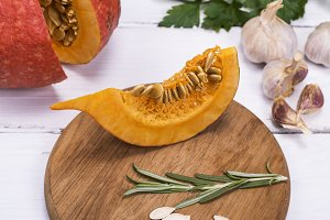 piece of fresh pumpkin with seeds