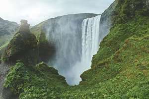 famous Skogafoss waterfall in southern Iceland. treking in Iceland.