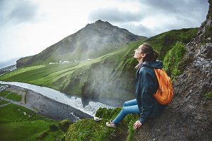 Cheerful woman walking and posing on nature in Iceland