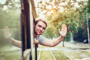 man enjoy ride public transport