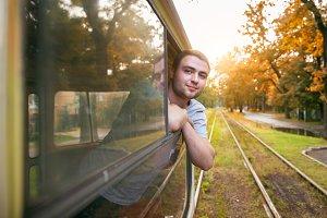 man enjoy ride public transport