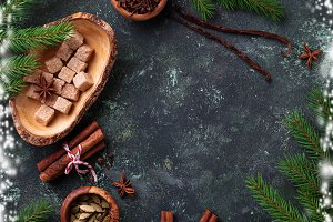 Traditional Christmas spices on green background.