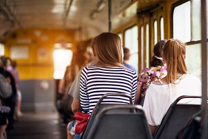 women take ride in public transport