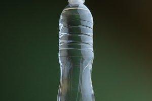 Plastic water bottle on the desk
