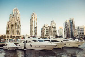 Luxury yachts parked on pier