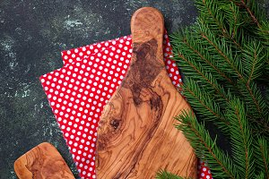 Christmas cooking background with cutting board