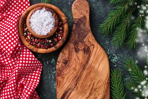 Christmas cooking background with cutting board and spices