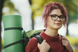 Portrait of a girl teenager tourist with backpack outdoor