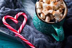 Hot chocolate with marshmallows on green