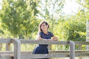Brunette posing outdoors