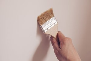 Painter painting the white wall